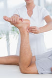 Physiotherapist doing leg massage to her patient Royalty Free Stock Photos