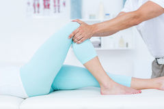 Physiotherapist doing leg massage to his patient Royalty Free Stock Photography