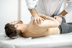 Physiotherapist doing manual treatment royalty free stock photo