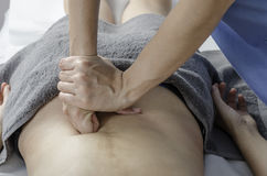 Physiotherapist doing a massage girl back. Deep muscle. stock images