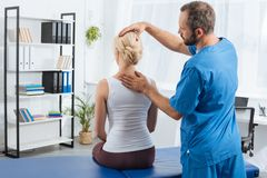 physiotherapist doing massage to woman