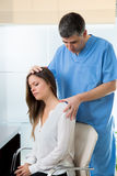 Physiotherapist doing myofascial therapy on woman patient Royalty Free Stock Photo