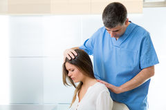 Physiotherapist doing myofascial therapy on woman patient Stock Images