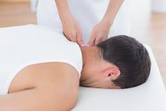 Physiotherapist doing neck massage Stock Photography