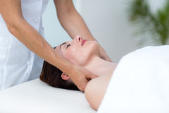 Physiotherapist doing neck massage. In medical office stock photos