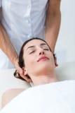 Physiotherapist doing neck massage Stock Photos