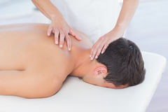 Physiotherapist doing neck massage to her patient Royalty Free Stock Image