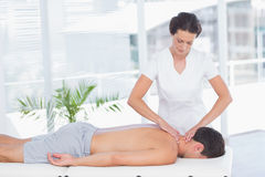 Physiotherapist doing neck massage to her patient Royalty Free Stock Images