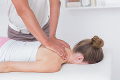 Physiotherapist doing neck massage to his patient Royalty Free Stock Photography