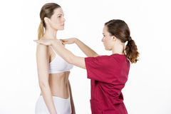Physiotherapist doing a physical examination. Of a woman Stock Photography