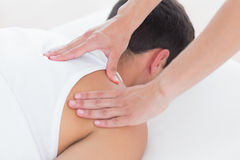 Physiotherapist doing shoulder massage Royalty Free Stock Photography