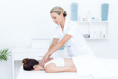 Physiotherapist doing shoulder massage Royalty Free Stock Photo
