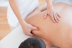 Physiotherapist doing shoulder massage to her patient Royalty Free Stock Photos