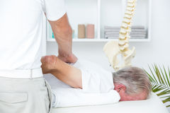 Physiotherapist doing shoulder massage to his patient Royalty Free Stock Image