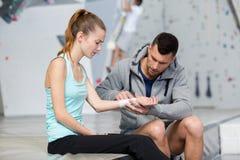 physiotherapist examining hand female