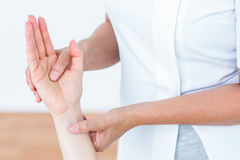 Physiotherapist examining her patients hand Royalty Free Stock Photo