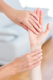 Physiotherapist examining her patients hand Stock Images