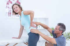 Physiotherapist examining his patient back Royalty Free Stock Photography