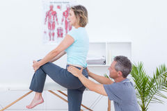 Physiotherapist examining his patient back Royalty Free Stock Images