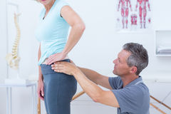 Physiotherapist examining his patient back Stock Photos