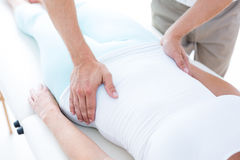 Physiotherapist examining his patients stomach Royalty Free Stock Photo