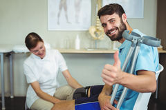 Physiotherapist examining patients knee Royalty Free Stock Photo