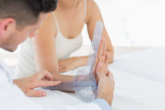Physiotherapist examining patients wrist Stock Photo