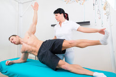 Physiotherapist exercising with patient in practice Stock Image