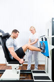 Physiotherapist exercising patient in sport therapy Royalty Free Stock Photo