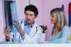 Physiotherapist explaining x-ray to patient Royalty Free Stock Photo