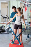 Physiotherapist giving advice his female patient. During body training Royalty Free Stock Image