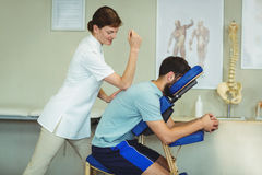 Physiotherapist giving back massage to a patient Royalty Free Stock Photography