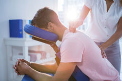 Physiotherapist giving back massage to a patient Stock Photo