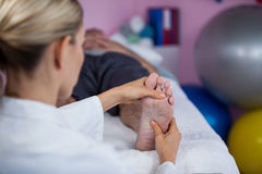 Physiotherapist giving foot massage to a patient Royalty Free Stock Photo
