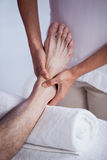 Physiotherapist giving foot massage to a patient Royalty Free Stock Photography