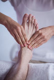 Physiotherapist giving foot massage to a patient Royalty Free Stock Photos