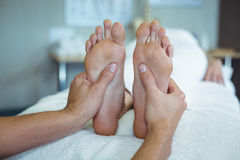Physiotherapist giving foot massage to a woman Stock Images