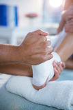 Physiotherapist giving foot massage to a woman Royalty Free Stock Photography