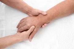 Physiotherapist giving hand massage to senior patient,. Closeup Royalty Free Stock Photo