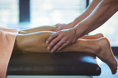 Physiotherapist giving leg massage to a woman Stock Photography