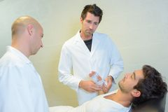 Physiotherapist giving physical therapy to patient in clinic Royalty Free Stock Images