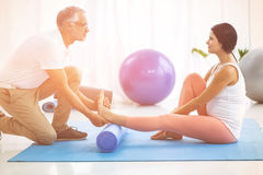 Physiotherapist giving physiotherapy to pregnant lady Royalty Free Stock Photo