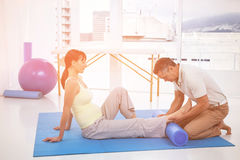 Physiotherapist giving physiotherapy to pregnant woman Stock Photos
