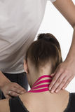 Physiotherapist healing the patient Stock Images