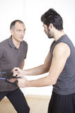 Physiotherapist helping with exercise Stock Photography