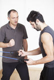 Physiotherapist helping with exercise. Physiotherapist helping patient with exercise Stock Photo