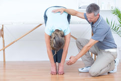 Physiotherapist helping his patient stretching royalty free stock images