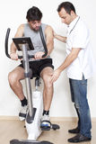 Physiotherapist helping patient with exercise Royalty Free Stock Image