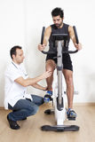 Physiotherapist helping patient with exercise Royalty Free Stock Photography