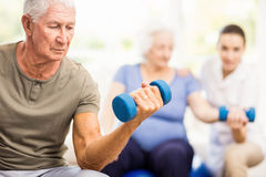 Physiotherapist helping patients with exercises Royalty Free Stock Photos